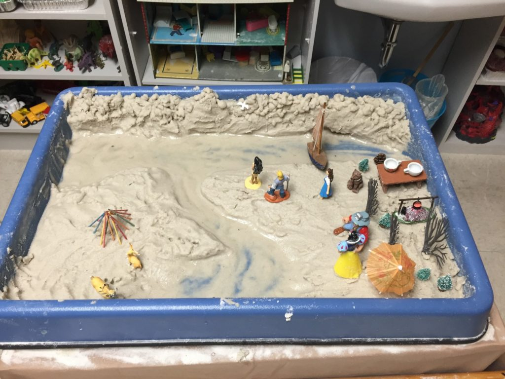 an example of a sandtray therapy tray with miniatures