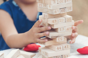 Girl kid playing Jenga games